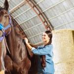 Joyful occupation. Beautiful professional horsewom...