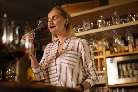 Nice attractive woman standing with a wine glass