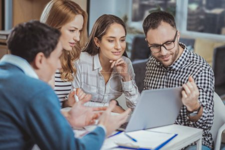 Optimistic four colleagues having online meeting