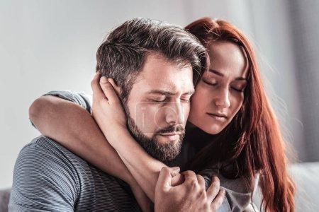 Nice beautiful woman hugging her boyfriend