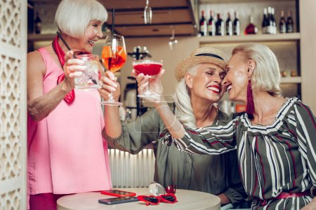 Photo for Reunion of friends. Happy positive aged women having fun while enjoying their reunion - Royalty Free Image