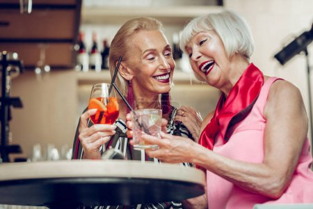 Photo for Real friendship. Low angle of delighted nice aged women speaking with each other - Royalty Free Image