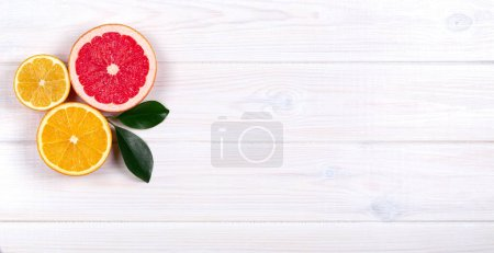 Photo for Colorful citrus fruits on white wooden background - Royalty Free Image