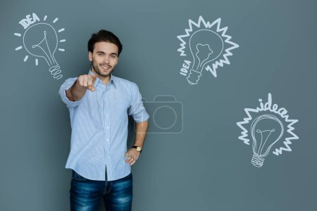 Yes you. Cheerful clever HR manager feeling happy and putting at young while getting a brilliant idea