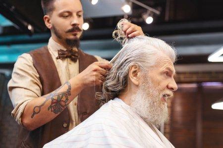 Emotional retired man wrinkling forehead