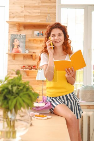 Art student feeling contended while speaking by phone