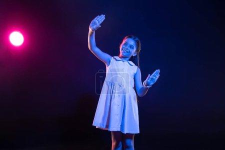 Alert schoolgirl touching an imaginary window
