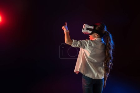 Excited schoolgirl wearing a VR headset