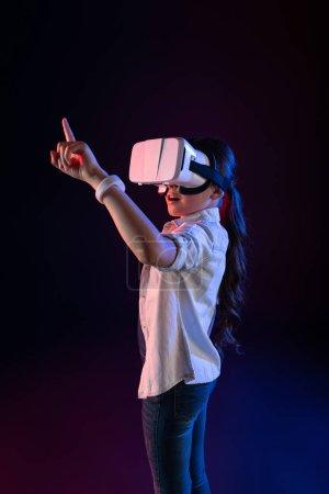 Amazed schoolgirl wearing a VR headset