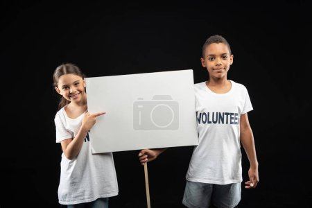 Alert volunteers holding a white table