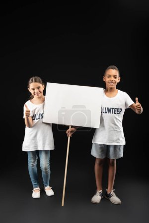 Exuberant volunteers holding a white table
