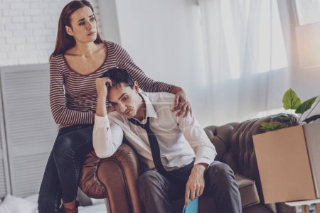 Sad nice man being supported by his wife