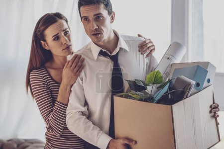 Pleasant sympathetic woman standing near her husband