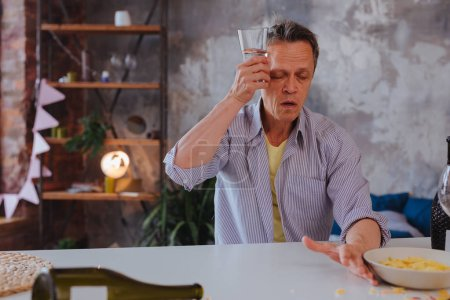 Haggard mature man restoring water balance