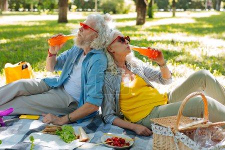 Happy nice couple enjoying their drinks