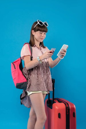 Alert girl standing with her phone