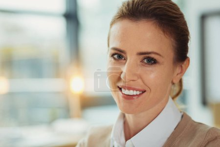 Positive manager smiling while being at work
