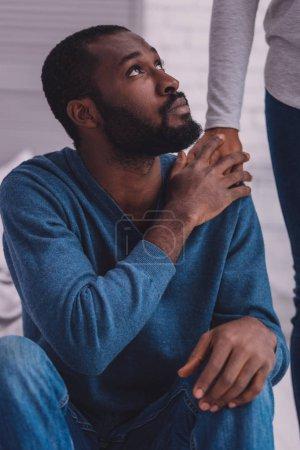 Attentive bearded man looking upwards