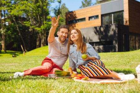 Cheerful man and woman having a picnic