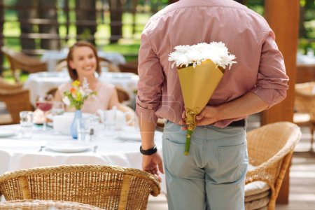 Caring husband presenting nice flowers to wife