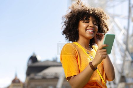 Pleasant upbeat woman reading text messages and smiling