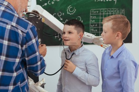 Cute pleasant boy wearing a stethoscope