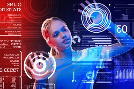 Photo for Creative teenager. Smart progressive teenager using futuristic device and putting her two hands on the screen while creating an incredible program - Royalty Free Image