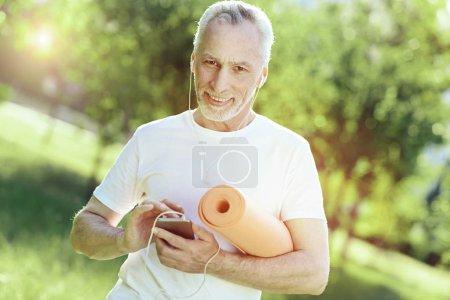 Progressive aged man listening to music