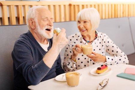 Positive senior couple enjoying lunch