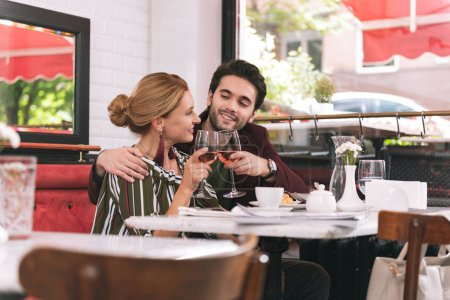 Sweet pleased couple assigning date