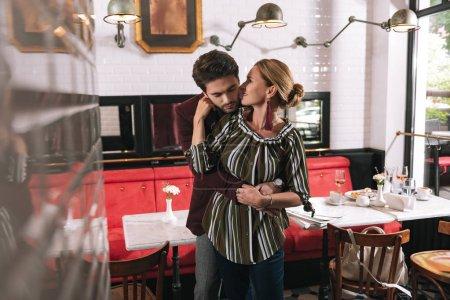 Secret of love. Pleasant mature woman kissing man ...