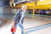 Positive nice man holding a bowling ball
