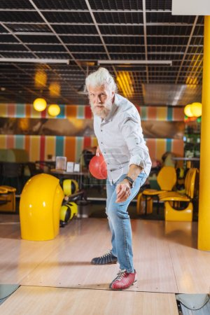 Nice pleasant man visiting a bowling club