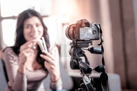 Delighted blogger making a video for her followers