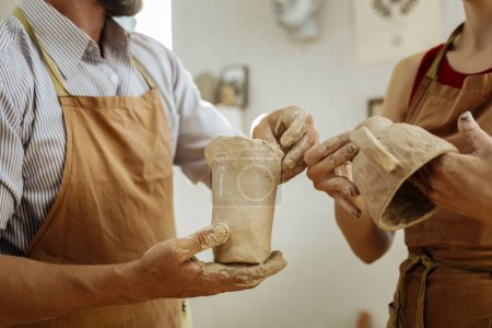 Man and woman attending pottery master class together