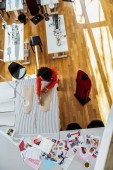 Bright dark-haired female designer spending workday in studio