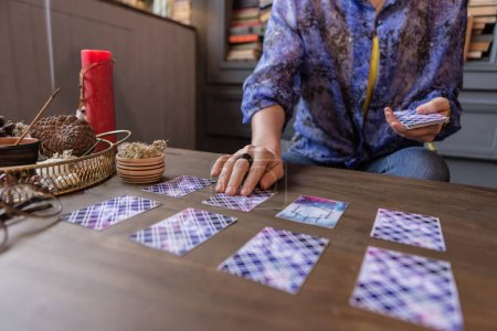 Photo for Prediction of future. Close up of tarot cards lying on the table while predicting the future - Royalty Free Image