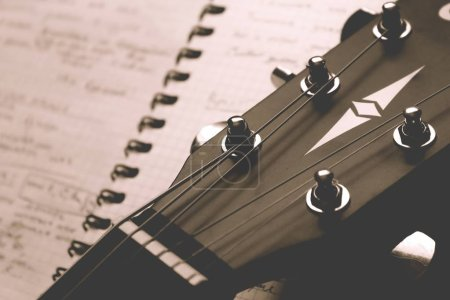 classical guitar with notebook close up, songwriting concept