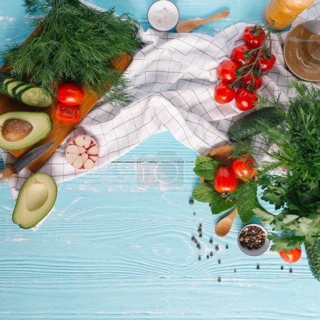 Photo for Ingredients for cream of avocado soup on blue wooden background - Royalty Free Image