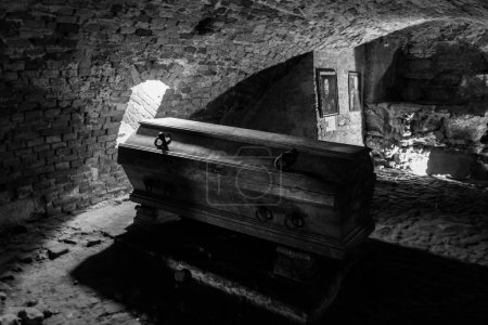 Inside view of crypt with old coffin