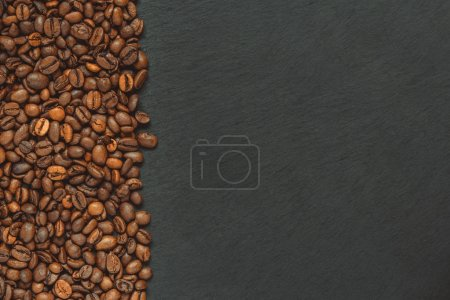 Photo for Coffee beans (good and bad grain) - arabica and robusta blend (roasted coffee grain). Black background. Top view. Copy space. - Royalty Free Image