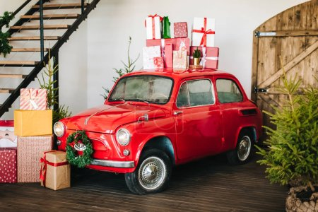 Photo for Gift boxes on roof of retro  car, Christmas decoration - Royalty Free Image
