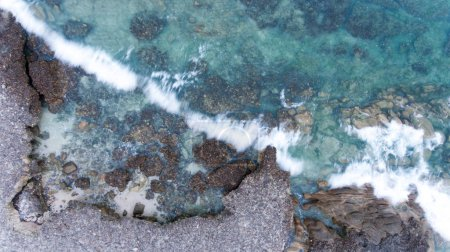 Photo for Sand, rock, and sea patterns on cristal clear waters. - Royalty Free Image