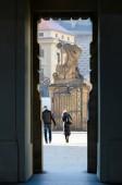 PRAGUE, CZECH REPUBLIC - JANUARY 21, 2019: Unidentified tourists go from gates of Mathias to gates of Titans in Prague Castle, Prague, Czech Republic