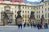 PRAGUE, CZECH REPUBLIC - JANUARY 22, 2019: Gate of Titans and gate of Mathias, Prague Castle, Prague, Czech Republic. Unknown tourists are on Hradchanskaya square