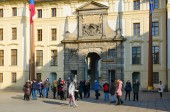 PRAGUE, CZECH REPUBLIC - JANUARY 21, 2019: Group of unknown tourists is located at Matias Gate in First Courtyard of famous Prague Castle, Prague, Czech Republic