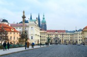 Tourists walk along Hradchanskaya Square in historic center of city, Prague, Czech Republic