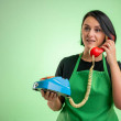 Female cook with green apron and black t-shirt, ta...