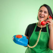 Female cook with green apron and black t-shirt, la...