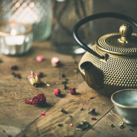 Traditional Asian tea ceremony arrangement over vintage wooden table background